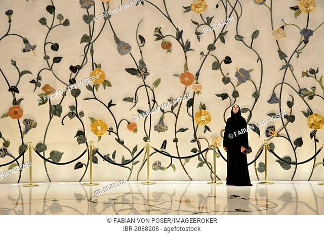 Veiled woman in the Sheikh Zayed Mosque, Abu Dhabi, United Arab Emirates, Arabian Peninsula, Asia