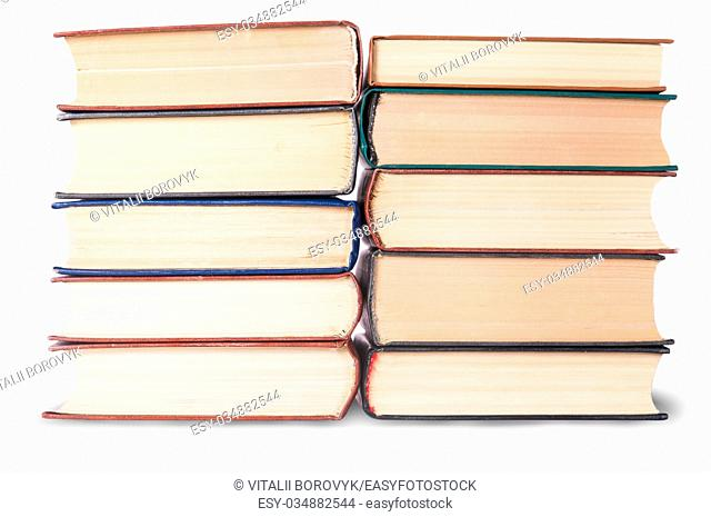 Two stacks of old books isolated on white background