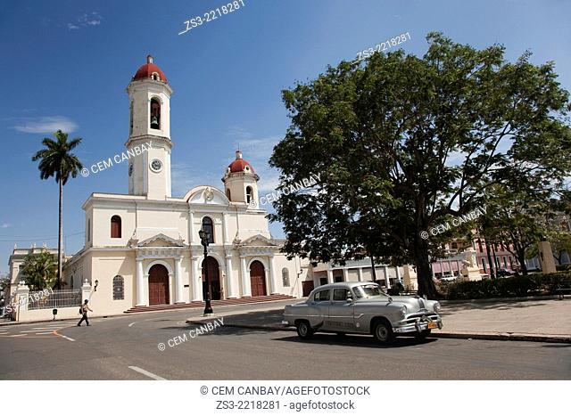Purisima Concepcion Cathedral in Jose Marti Park with an old American car in the foreground, Cienfuegos, Cuba, West Indies, Central America