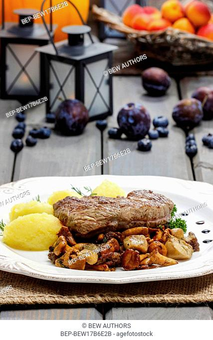 Roasted beef with mushrooms in autumn setting. Selective focus