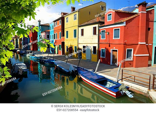 Boat and colored houses in Venetian Burano, Italy