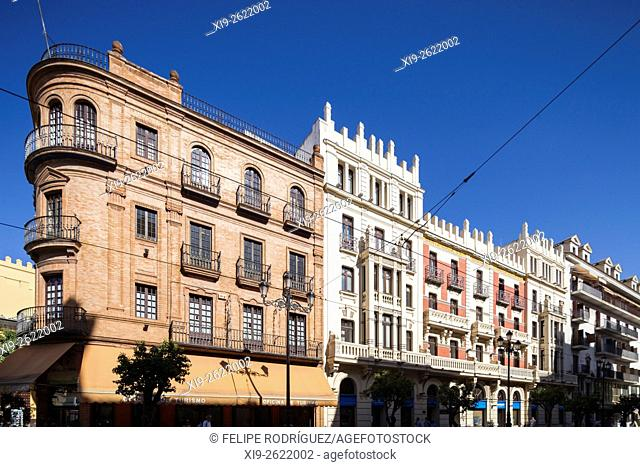 Avenida de la Constitucion street, Seville, Spain. On the left, in red brick, the building of Seville Tourist Office, a project by Anibal Gonzalez (1926)