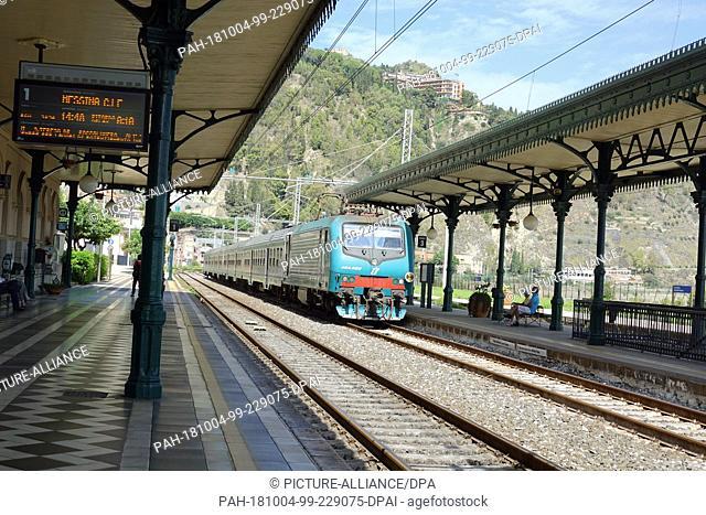 04 September 2018, Italy, Sicily: The Taormina-Giardini railway station. Taormina railway station (officially called Taormina-Giardini) is located in the...