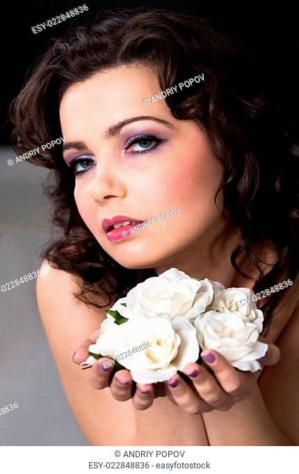 Young Woman Holding White Roses