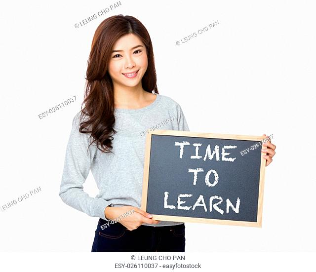 Asian woman hold with black board and showing phrase of time to learn