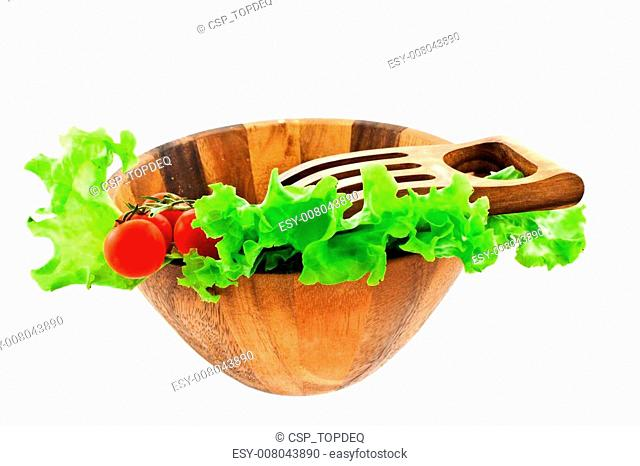 lettuce leaves and tomatoes in a salad bowl