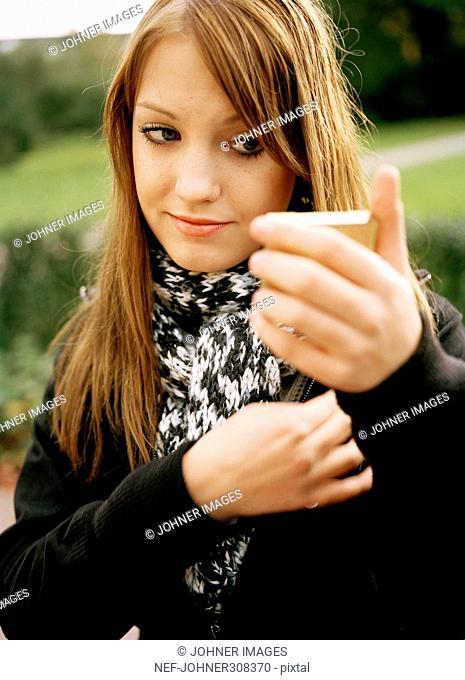 A teenage girl looking in a mirror