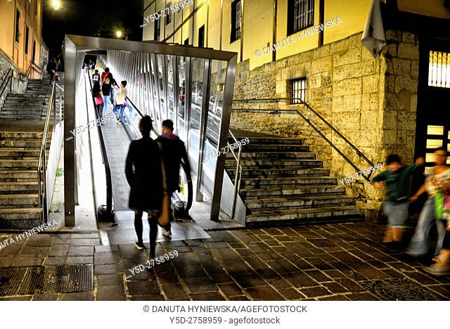 Street scene at night, stairs and moving walkway connecting old town with the city, Vitoria-Gasteiz, Alava, Araba, Basque Country, Spain