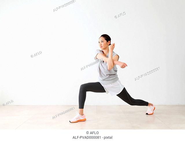 Attractive Japanese woman training in a airy room