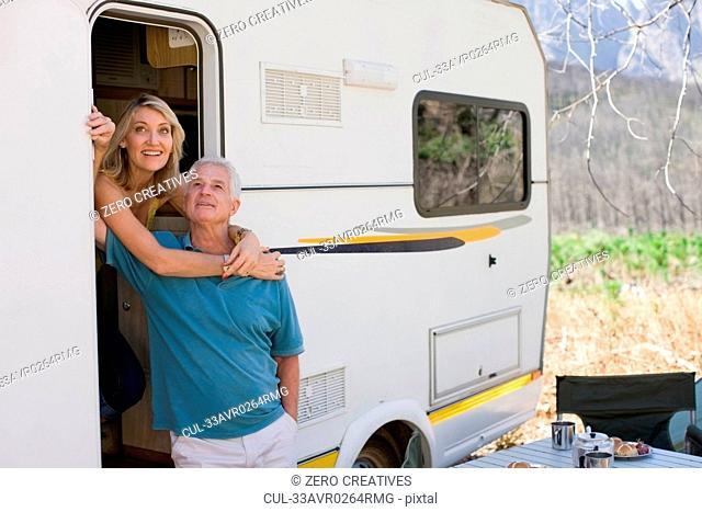 Older couple at door of RV
