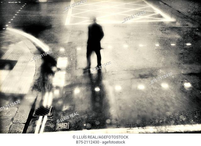 Blured silhouette of a man crossing a street in London, England, UK, Europe