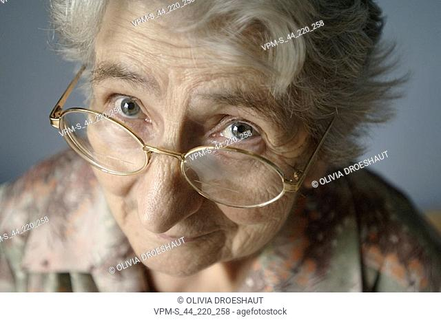 Portrait of a senior woman wearing eyeglasses and thinking