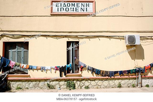 The railway station of Idomeni, laundry drying in the sun, refugee camp of Idomeni in Greece at the frontier to Macedonia, April, 2016