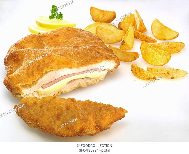 Chicken Cordon Bleu with potato wedges and lemon slices