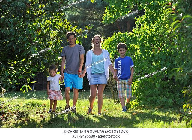 family walking in a garden, Ile-de-France region, France, Europe