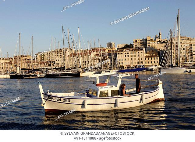 France, Provence, Bouches-du-Rhone department13, City of Marseille seen from the sea in a local boat called 'pointu'