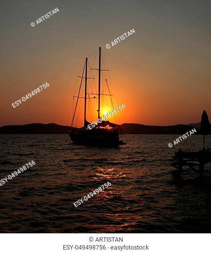 Yacht silhouette at dawn in Marmaris, Turkey