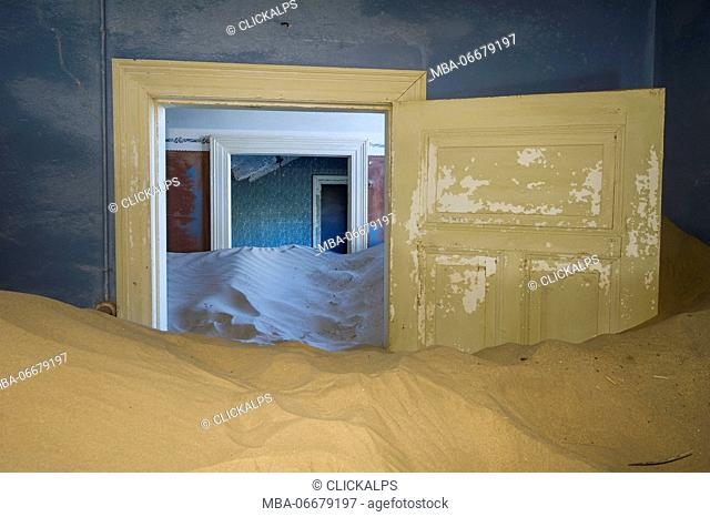 Kolmanskop, Southern Namibia, Africa. Old abandoned mining town's houses with sand