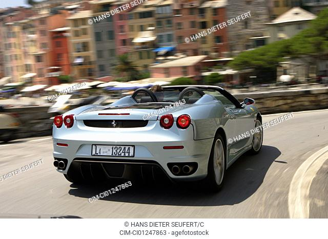 Car, Ferrari F430 Spider F1, model year 2005-, silver, Convertible, driving, diagonal from the back, rear view, City, landsapprox.e, open top