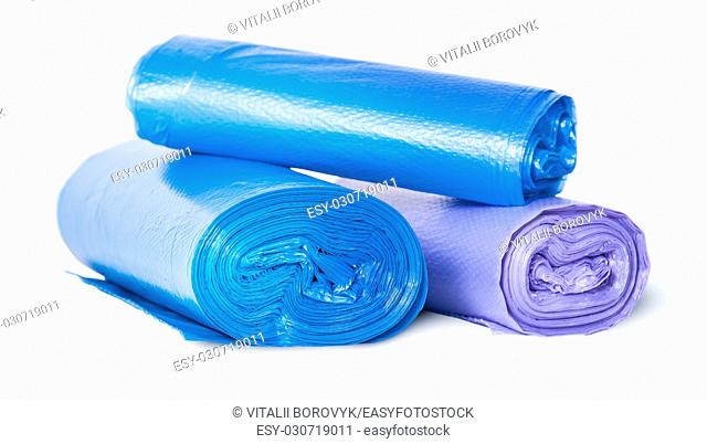 Multicolored rolls of plastic garbage bags isolated on white background