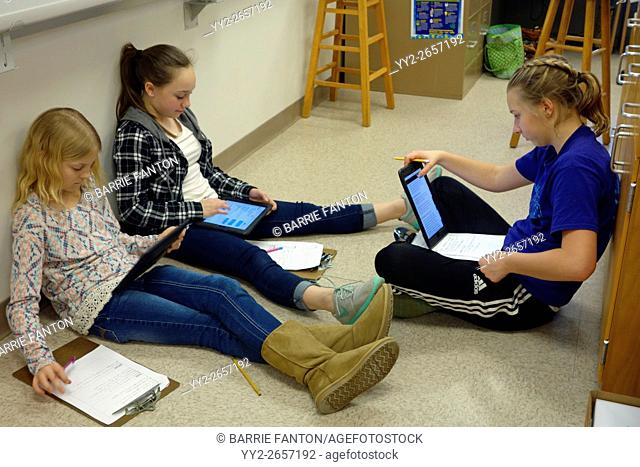 6th Grade Girls Working Together on Science Project, Wellsville, New York, USA
