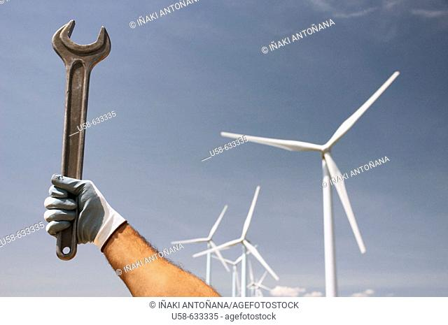 Holding a wrench in a windfarm in Navarra, Spain