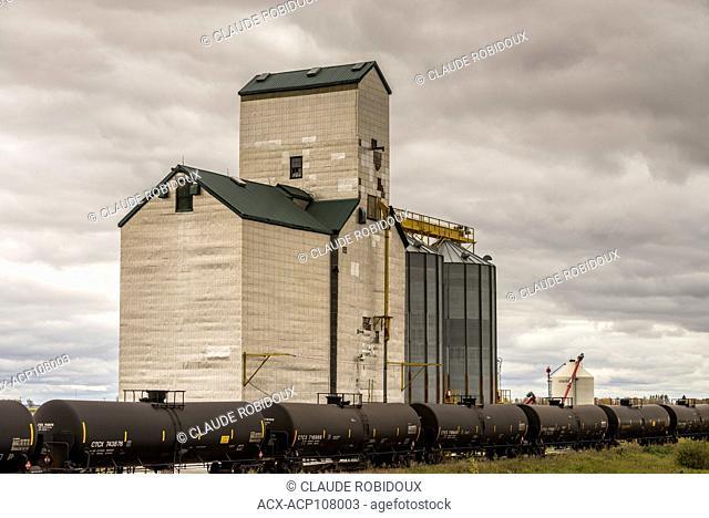 Freight train and grain elevator in Saskatchewan, Canada