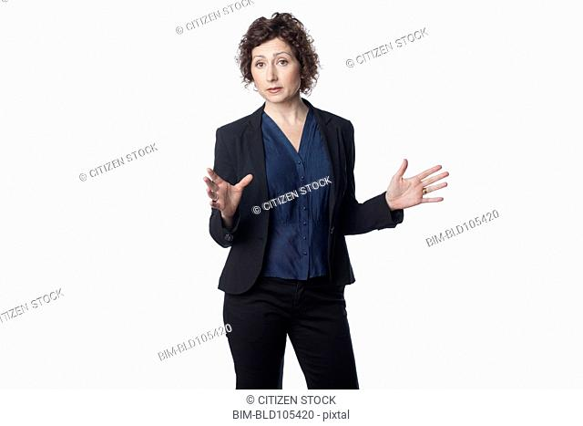 Smiling businesswoman with arms outstretched