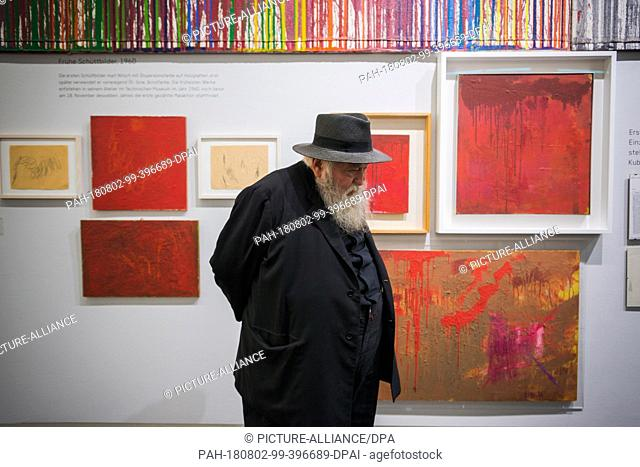 """01 August 2018, Austria, Mistelbach: The Austrian painter and action artist Hermann Nitsch stands in front of some of his works in the """"""""nitsch museum"""""""""""