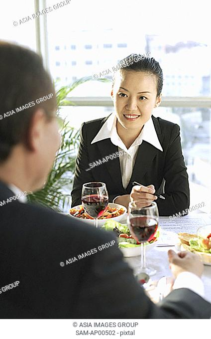 Executives discussing over lunch