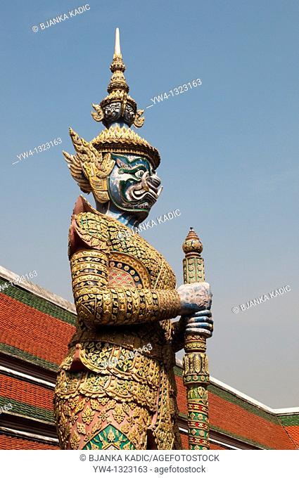 Yaksha statue, gaudy demon from the Ramayana, Wat Phra Kaeo, Bangkok, Thailand