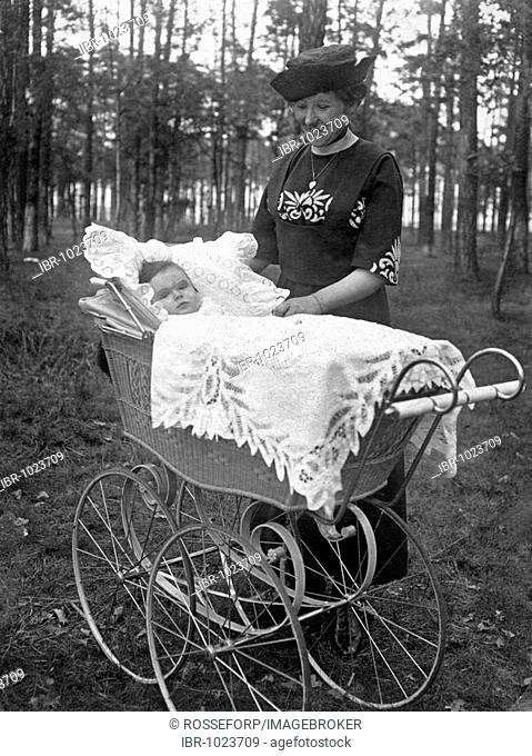 Historic photograph, woman with baby in a pram