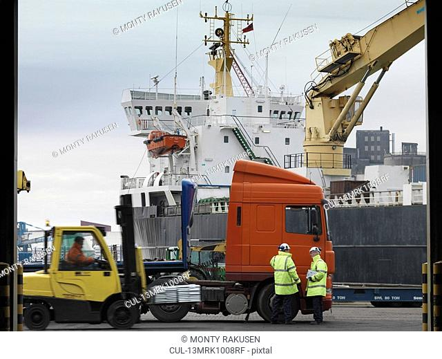 Port Workers With Lorry & Ship
