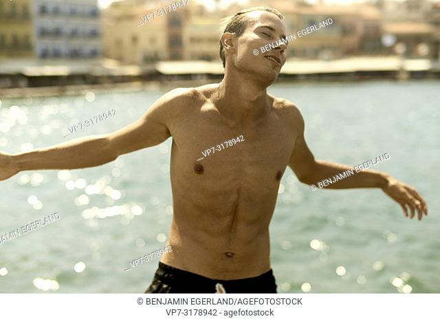 young man at harbour of Chania, Crete, Greece