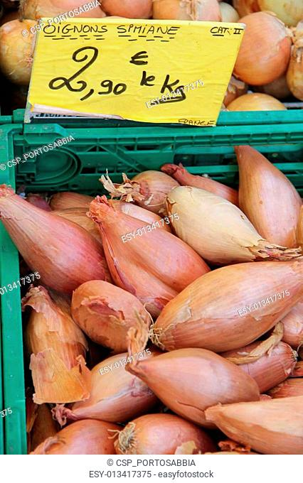 Onions in wooden crates