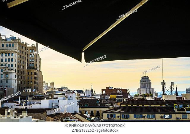 View oa black sunshade in a building roof of the center of Madrid city, Spain