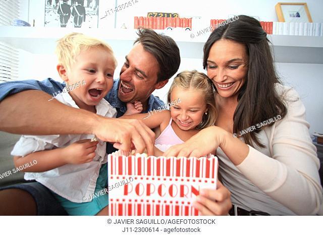 Family fun, eating popcorn
