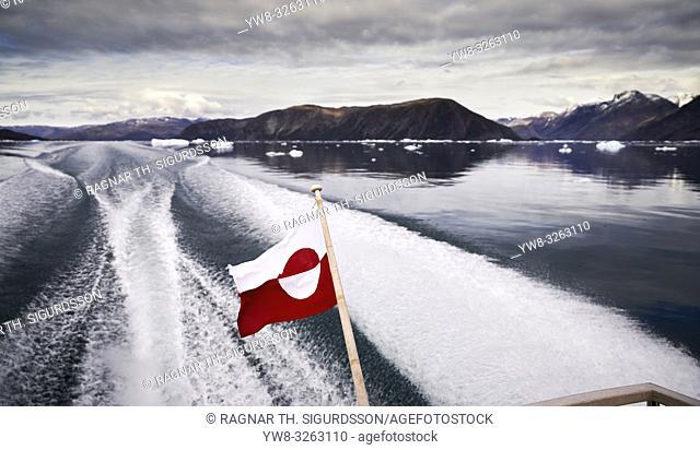 Greenlandic Flag, and wake on Eiriksfjordur, South Greenland