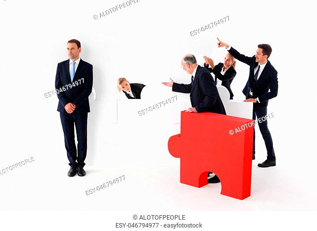 Business team and lazy businessman