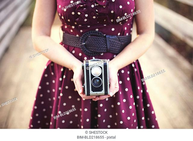 Woman photographing with vintage camera