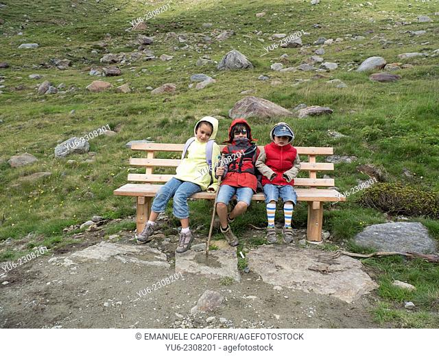 Children during a hike in the mountains, Alta Valtellina, Sondrio, Lombardy, Italy