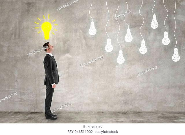 idea concept with businessman and yellow bulb painted on concrete wall above head. 3D render