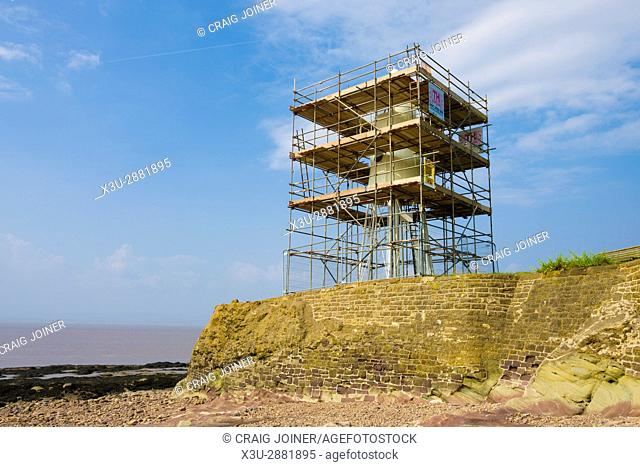 Black Nore Lighthouse surrounded by scaffolding during repainting. Portishead, North Somerset, England