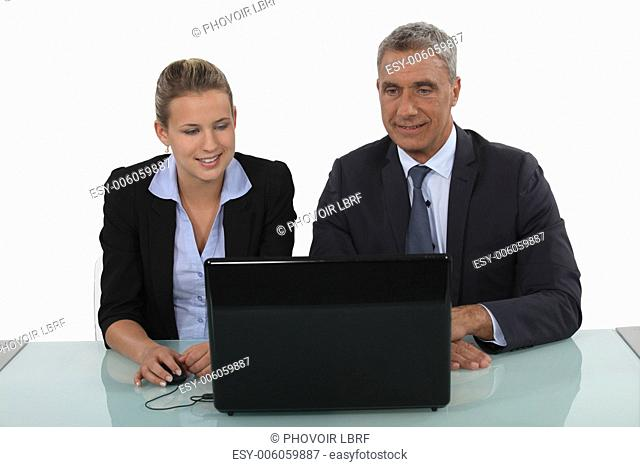 Professionals watching a slide show