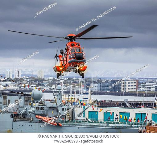 Search and Rescue Helicopter doing drills over Reykjavik, Harbor during the annual Seaman Day Festival