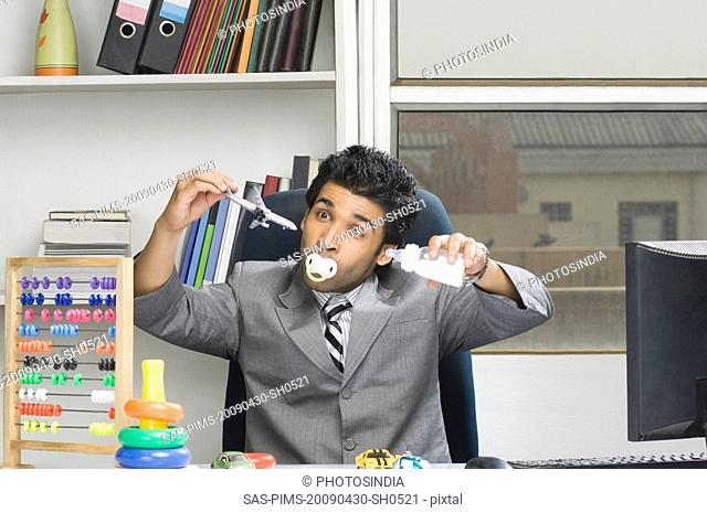 Businessman behaving like a kid in an office