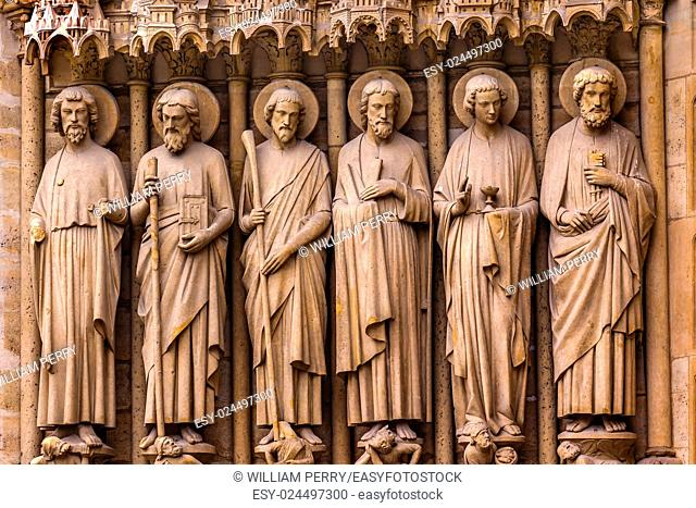 Biblical Saint Statues Door Notre Dame Cathedral Paris France. Notre Dame was built between 1163 and 1250 AD
