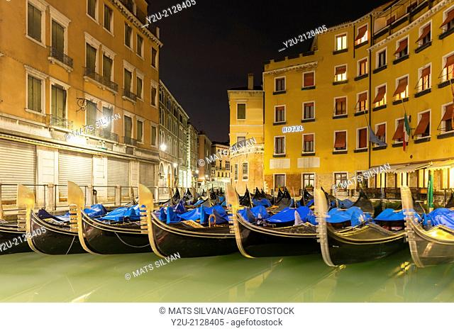 Gondola at night parked close to a hotel in Venice Italy