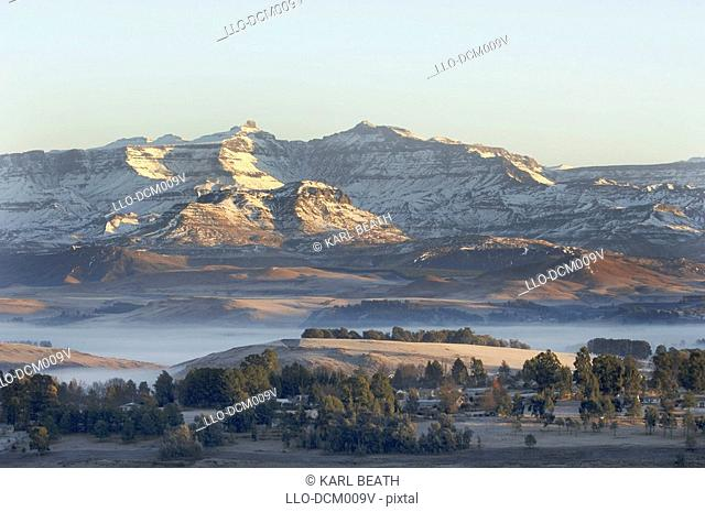 Winter snow on the Giant's Cup above the town of Underberg, Underberg, Southern Drakensberg, KwaZulu Natal, South Africa