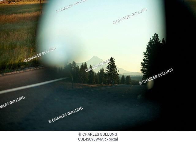 Mount Hood seen in car mirror, Portland, Oregon